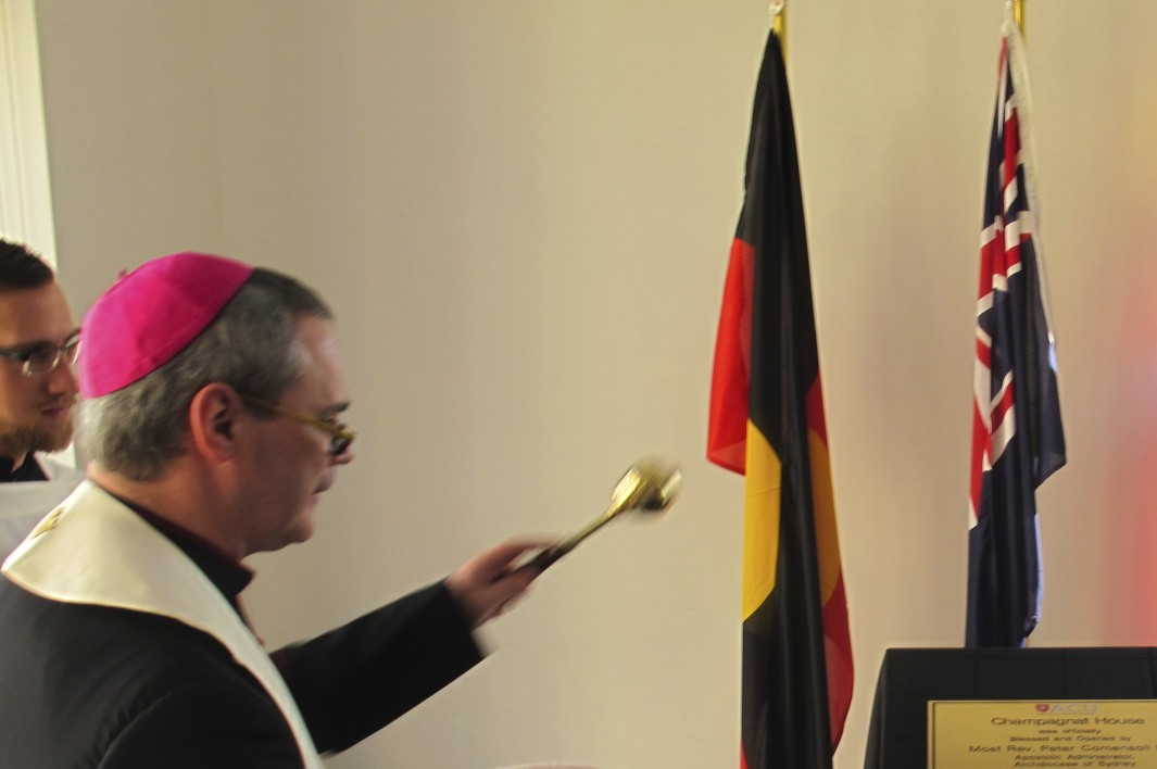 Bishop Peter Comensoli blesses the plaque.