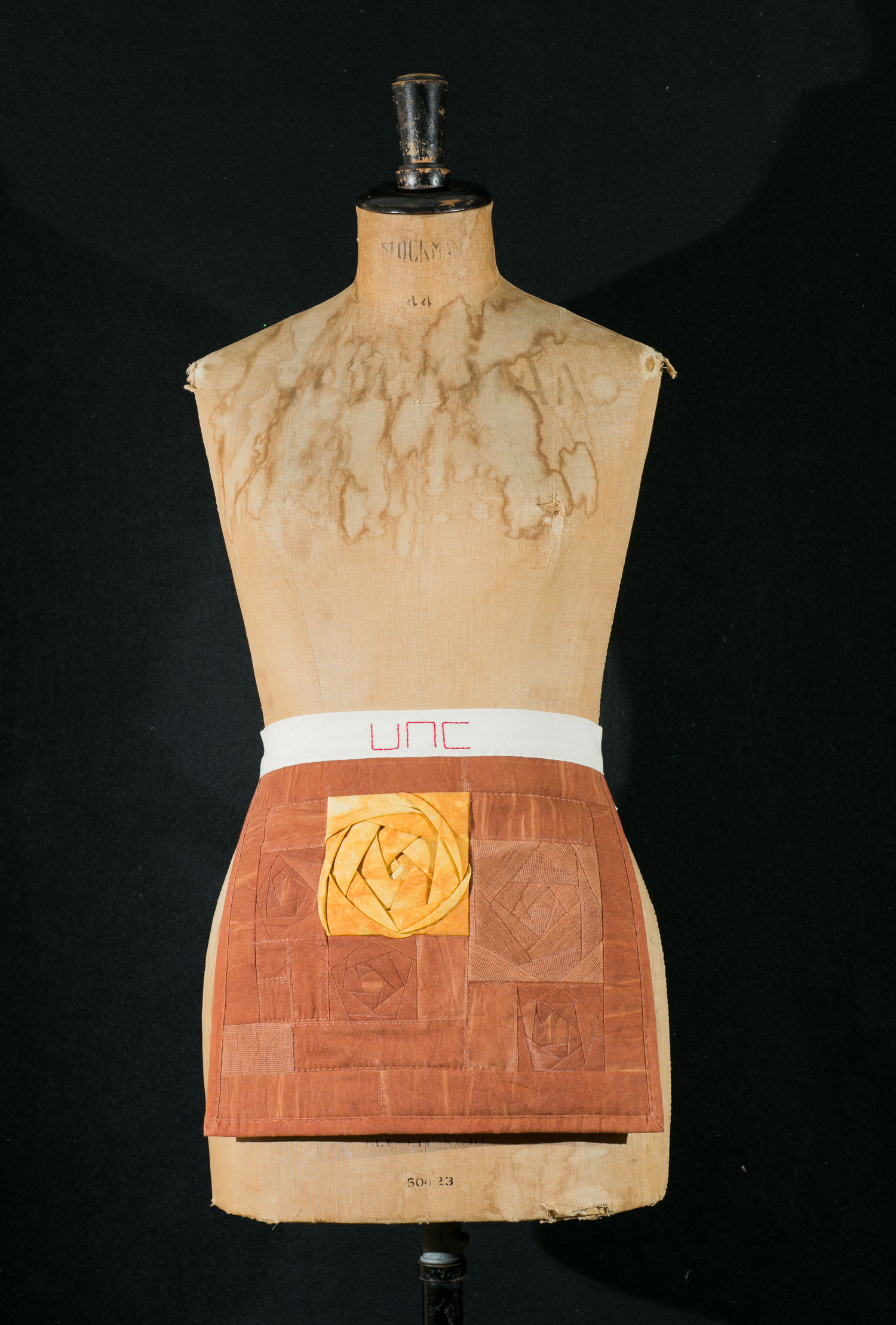 Mary Elizabeth Arnold Hines: My Mother's Sister      Materials:    Jeju Island persimmon dyed cotton, Jeju Island persimmon dyed cotton gauze, hand dyed cotton,   cotton muslin, chief value cotton batting, cotton embroidery floss, cotton thread, polyester thread    Techniques:    Machine sewn 3D and flat, traditional and improvisational patchwork, running stitch, backstitch embroidery, bat knot      2014