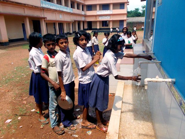 - Schoolchildren in the Birbhum District in West Bengal, India, wait in line for fresh drinking water filtered by the HIX nano system. (Photo courtesy of Arup SenGupta/Lehigh University)