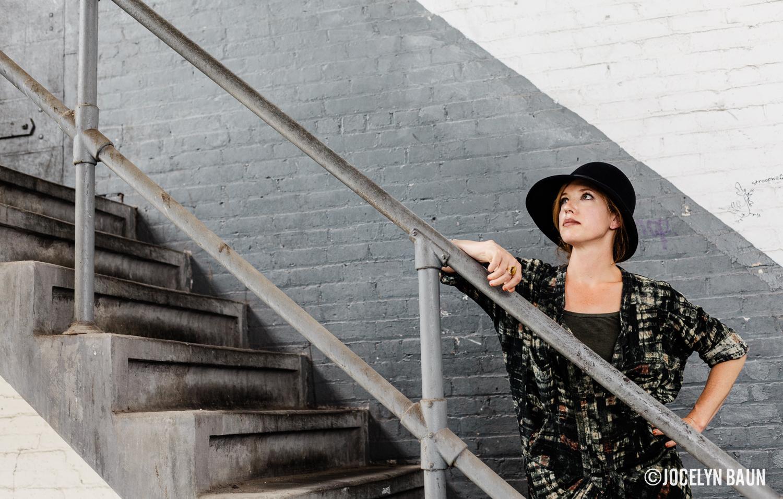 Milliner Amy Lehfeldt of  Lehfeldt  in her studio's stairwell.