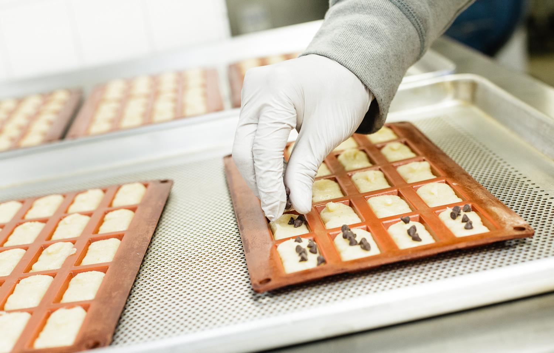 Preparing chocolate chip financiers at Canelé by Céline.