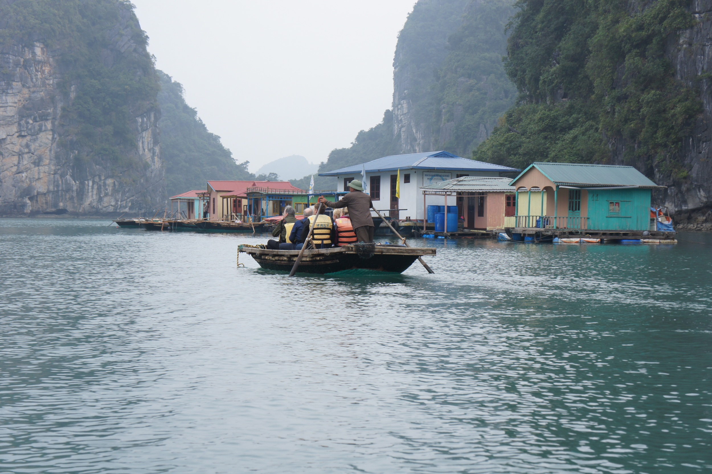 Tourists are rowed around by locals in bamboo boats (this was the boat ahead of us).