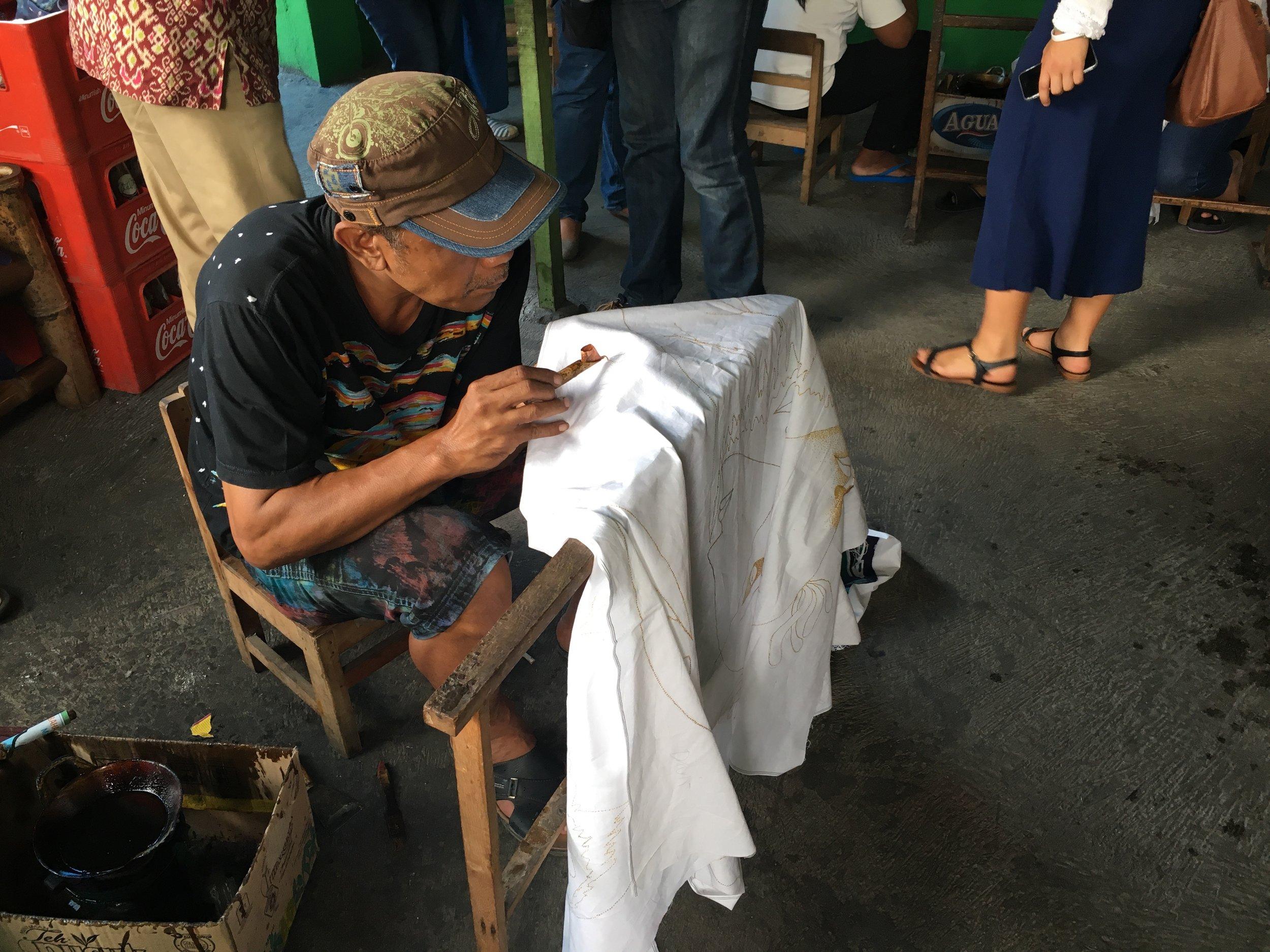 Making batik designed in hot wax.