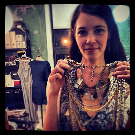 Susan in her studio, showing off a major statement necklace (worn by Eve in a music video!) that she recently sold