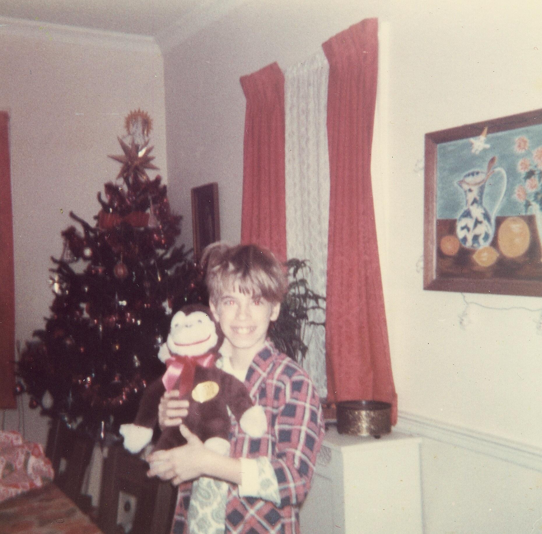 David and his stuffed monkey.