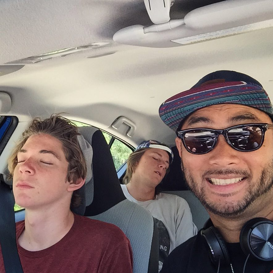 """Our friend Allen Chua, the producer of the film """"Restored Me"""" and founder of the Millennial Movement driving to their next location with tow tired boys in the car."""