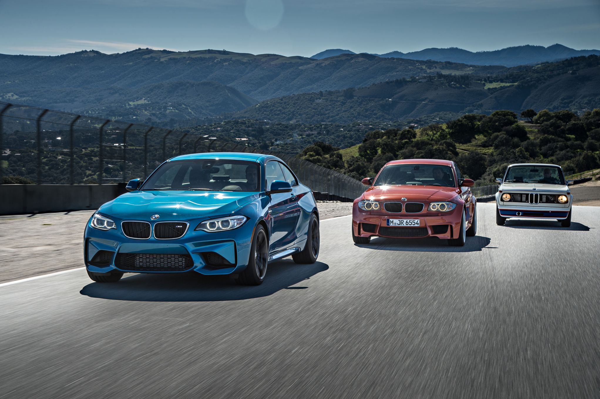 2016-bmw-m2-bmw-2002-turbo-and-bmw-1-series-m-coupe-front-three-quarter-in-motion.jpg