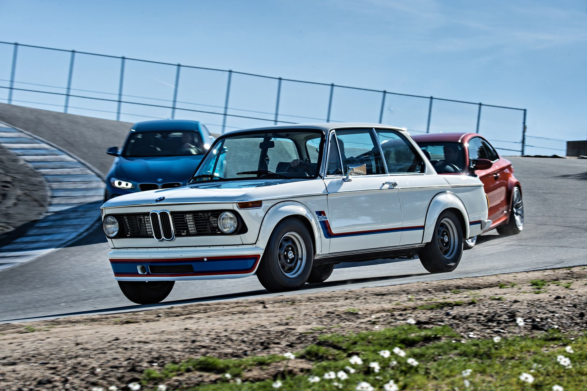 2016-bmw-m2-bmw-2002-turbo-and-bmw-1-series-m-coupe-front-three-quarters-in-motion.jpg
