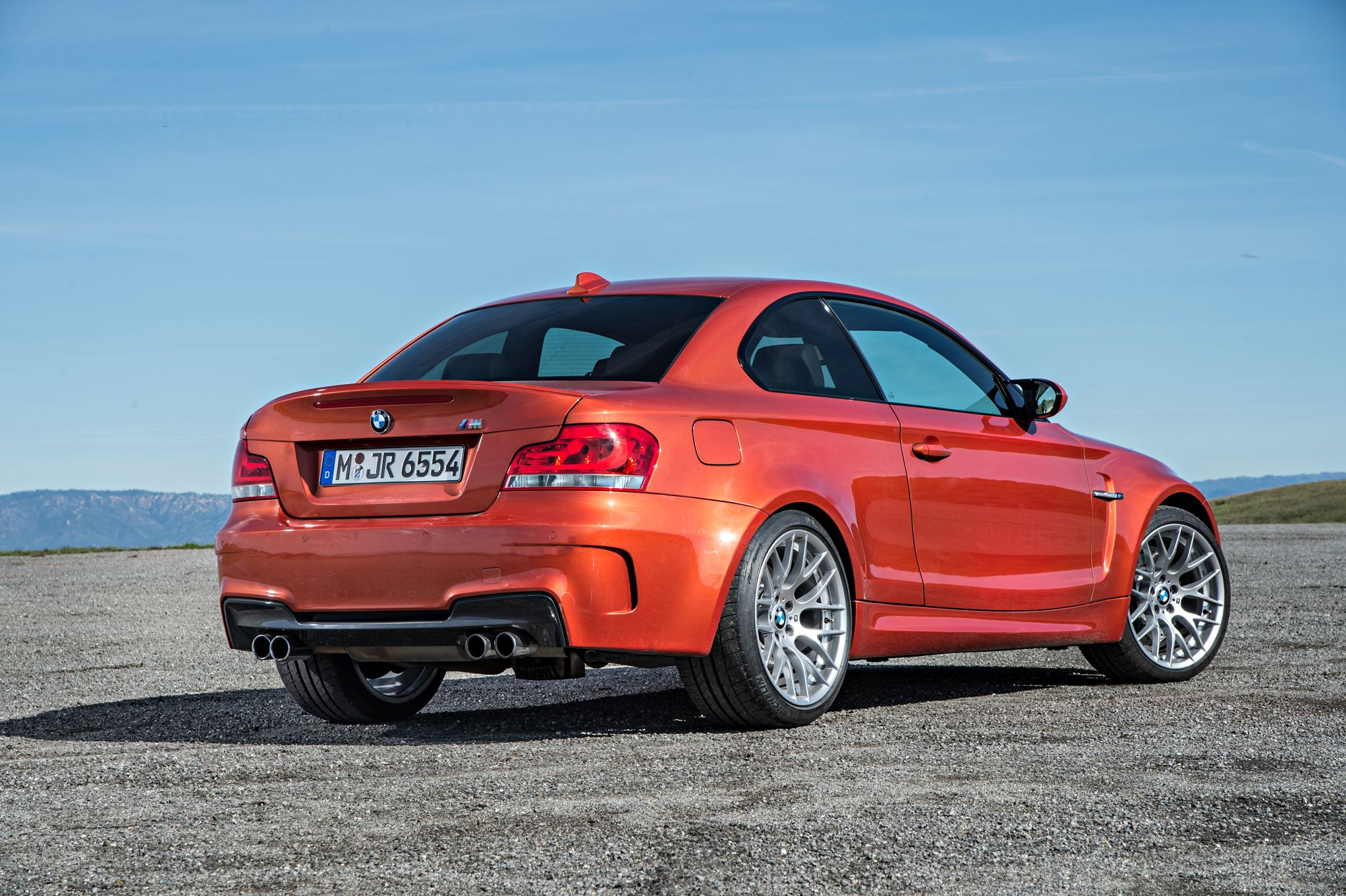 bmw-1-series-m-coupe-rear-three-quarter-in-motion-02.jpg