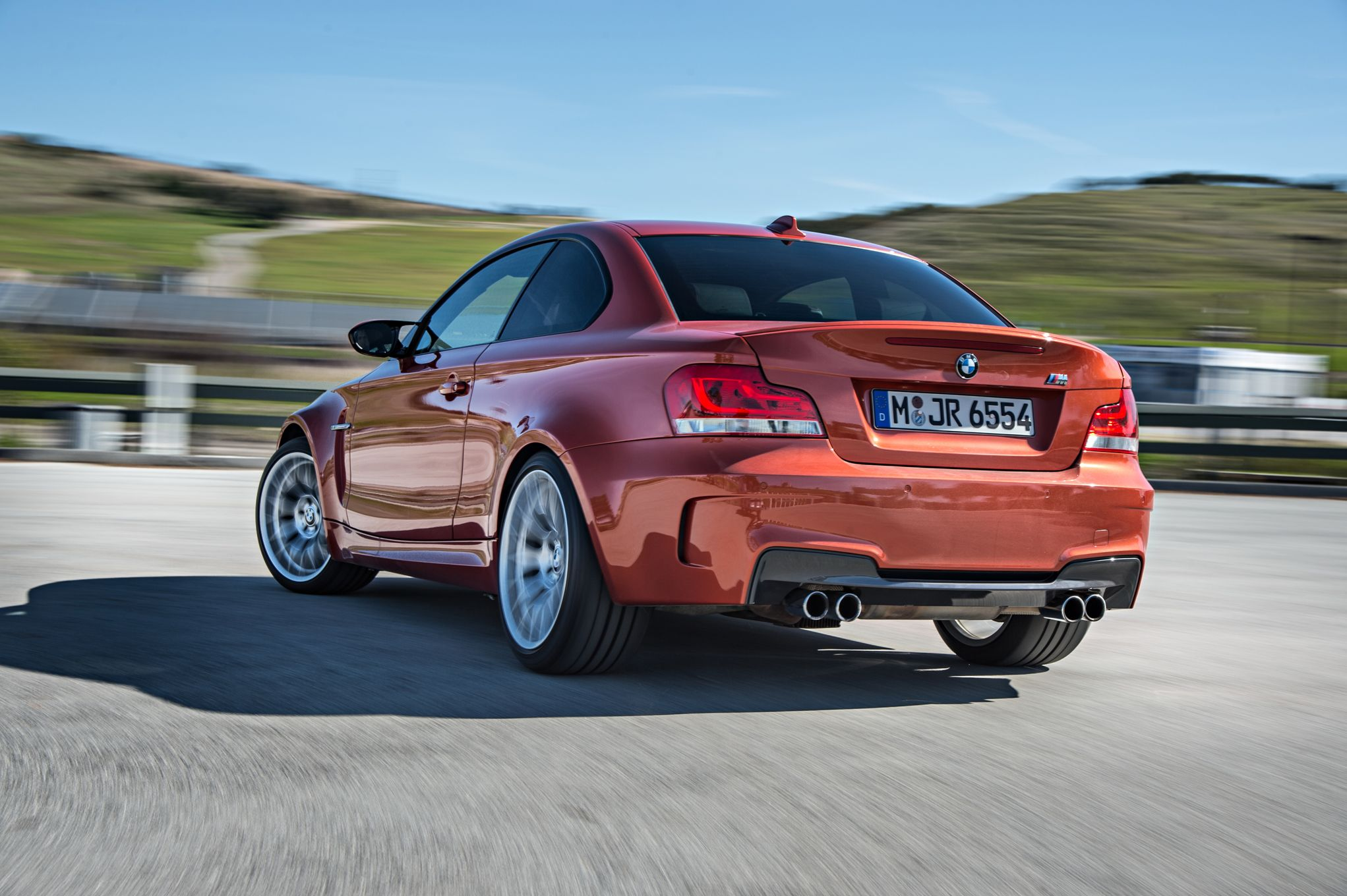 bmw-1-series-m-coupe-rear-three-quarter-in-motion.jpg