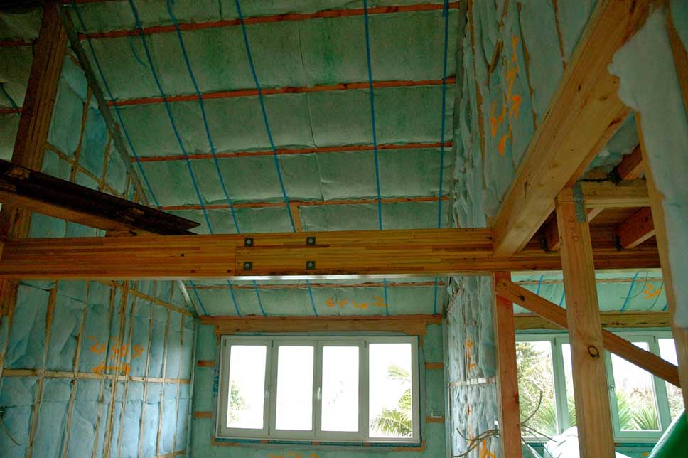 The blue insulation in the internal walls is a noise insulation product, also from Autex.