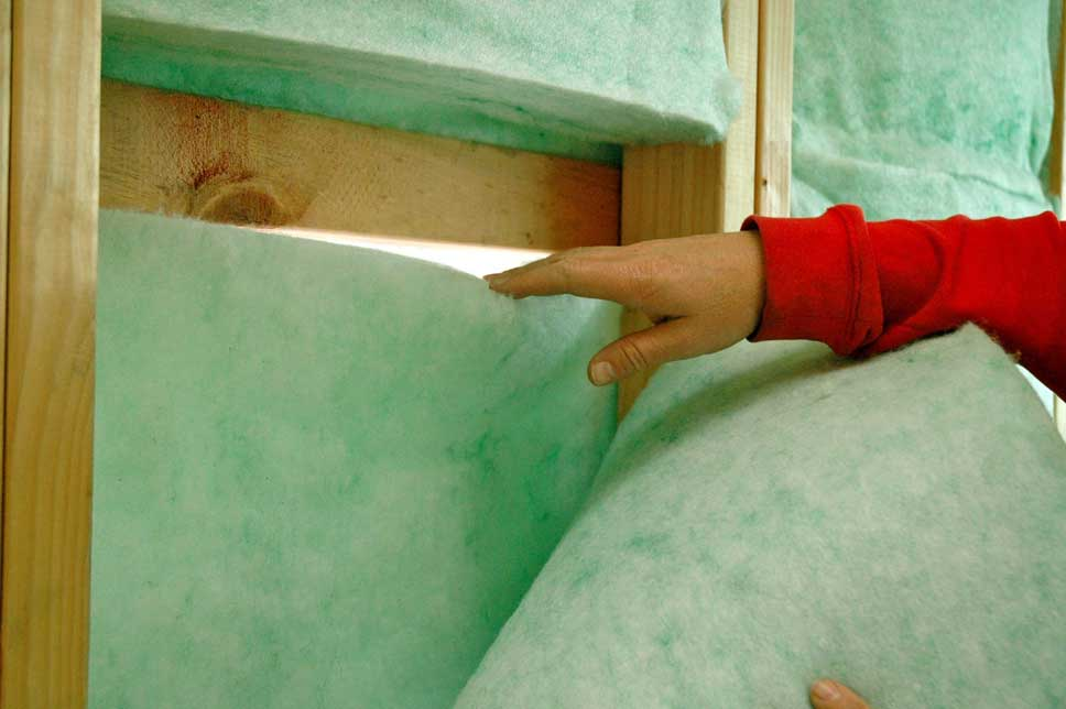 Showing the double layer of insulation, one of the keys to living without heating.