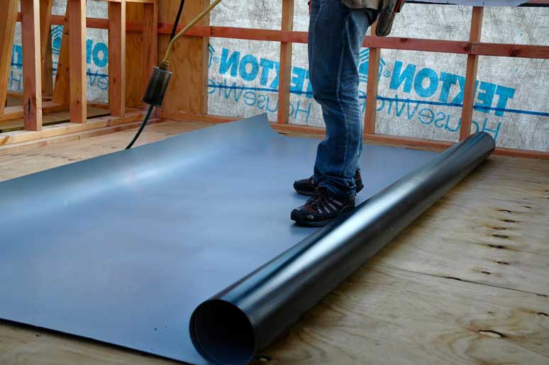 Rolling out the membrane. The wide membrane width means less joins are required.