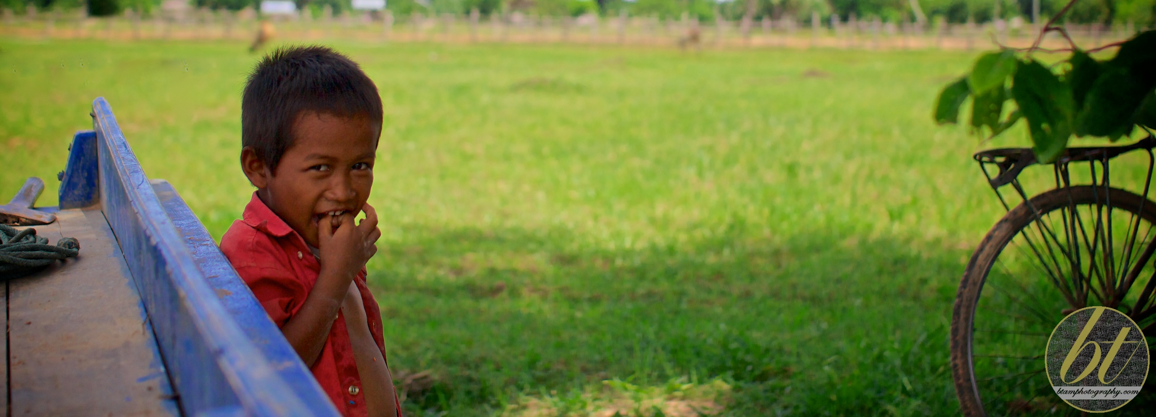 cambodian boy hanging around his family farm
