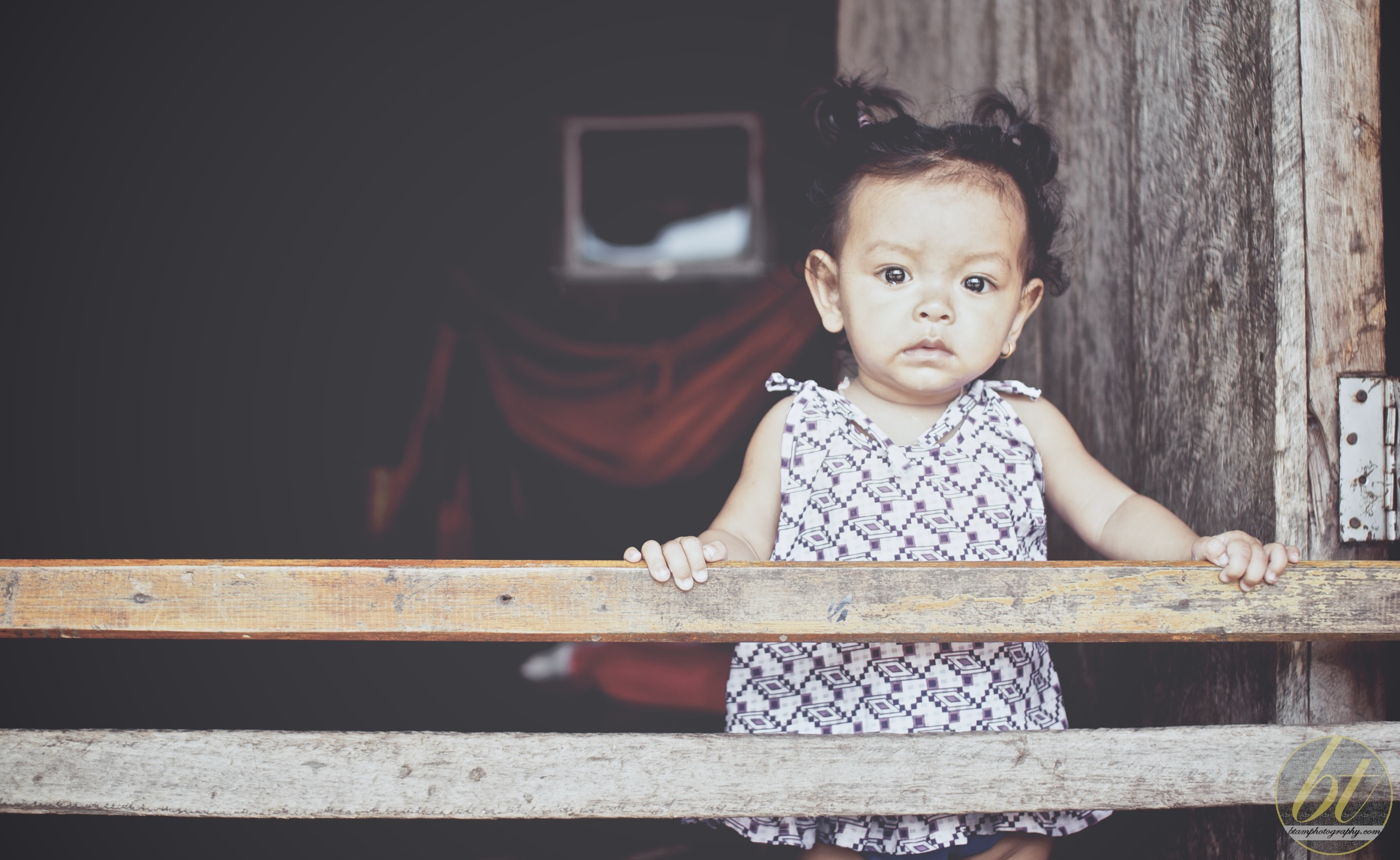 little girl looking out of her house, Sihanoukville fishing village
