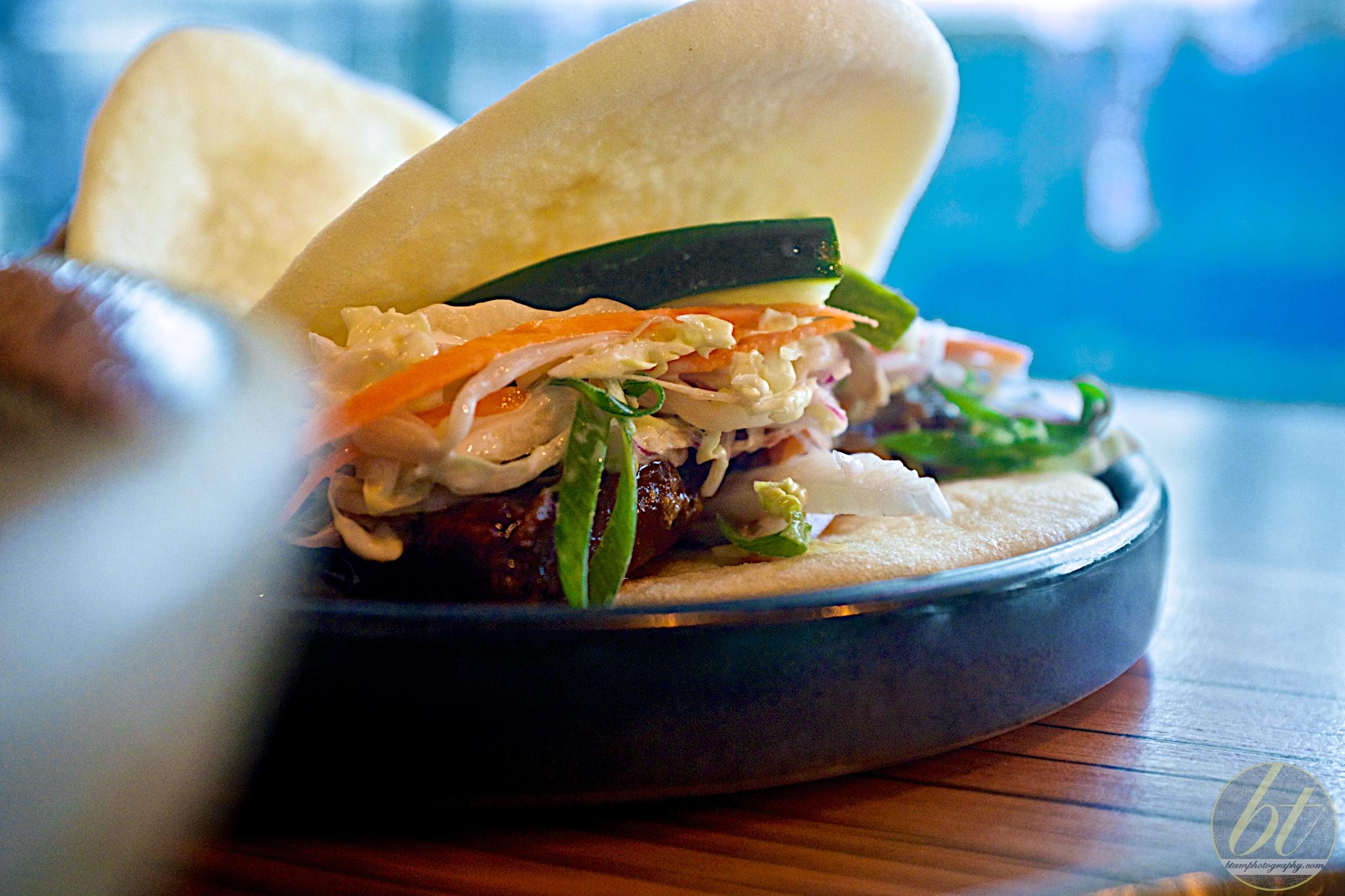 Pork belly bao with asian slaw ($8)