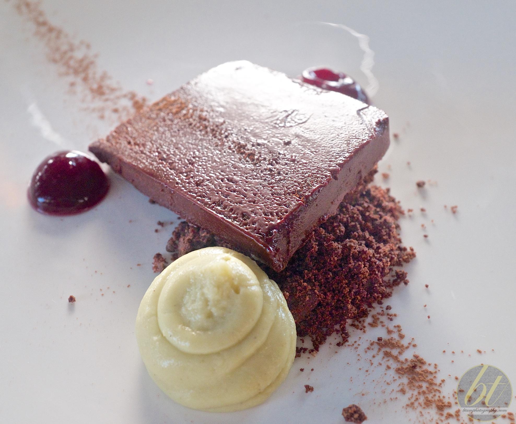 Chocolate marquise, pistachio cream, chocolate crumbs, red wine gel ($15)