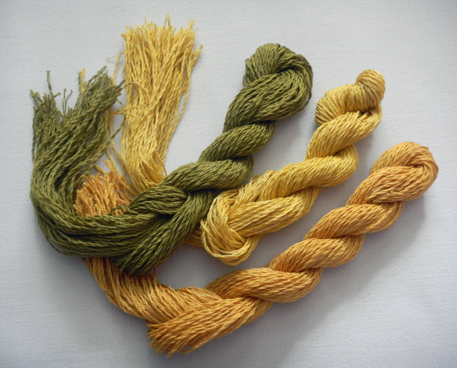 Red Onion Skin, Dahlia overdyed with marigold, and Yellow Onion Skin, by Kelly McKaig