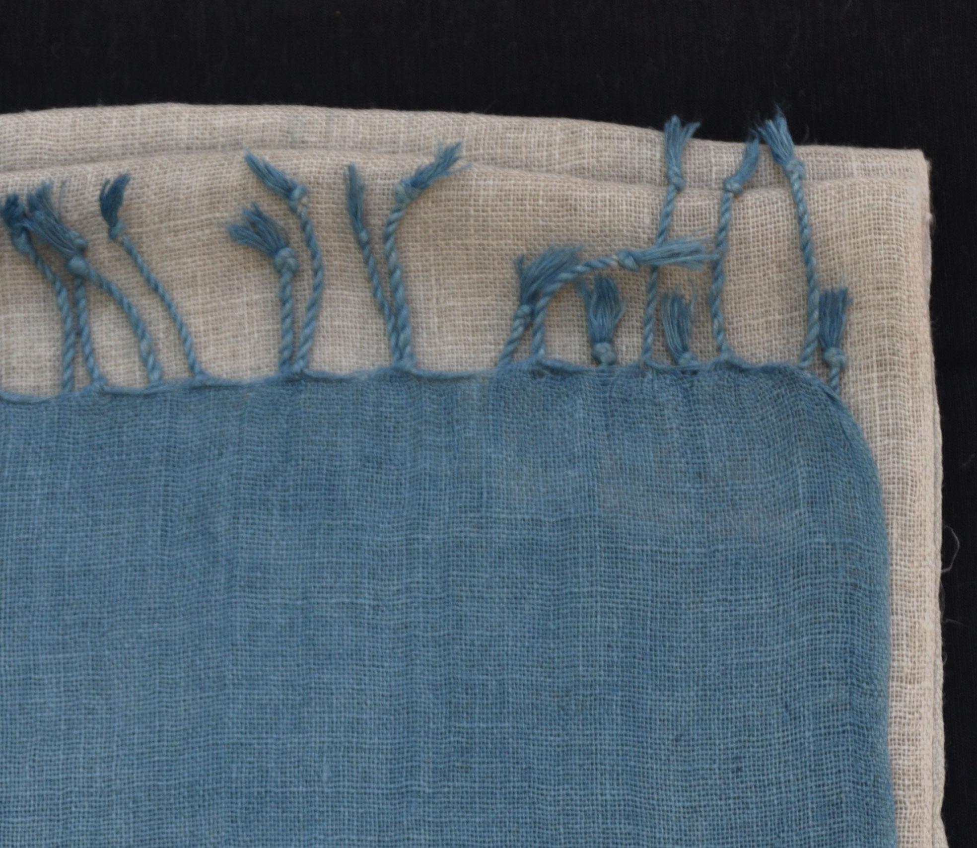 Folded linen scarf with indigo