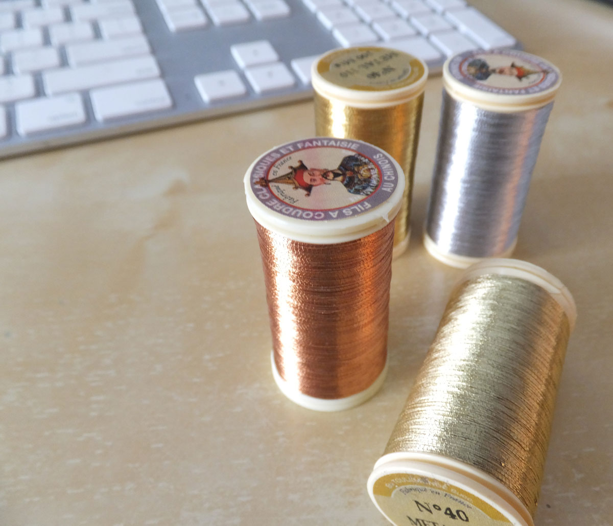Thinking about using the Maison Sajou  metallic threads  from my shop. I've never stitched with these so I am beginning to do just that.