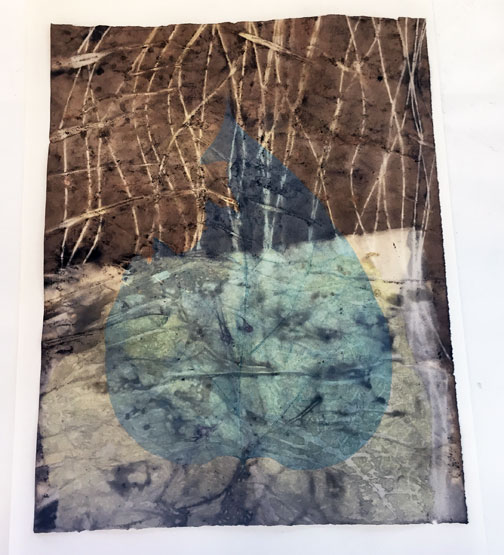 Eco print on paper with Catalpa leaf and black walnut, then over-dyed with a pale blue transparent soy-based etching ink. (I mixed this color myself)
