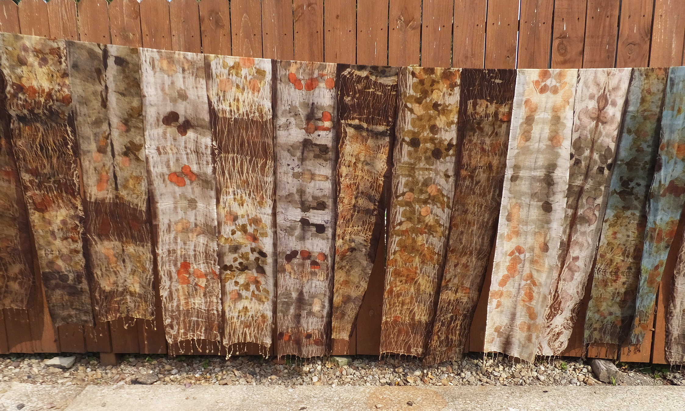 100% Wool scarves, eco printed using leaves and black walnut. Scarf on far right is over-dyed in indigo.