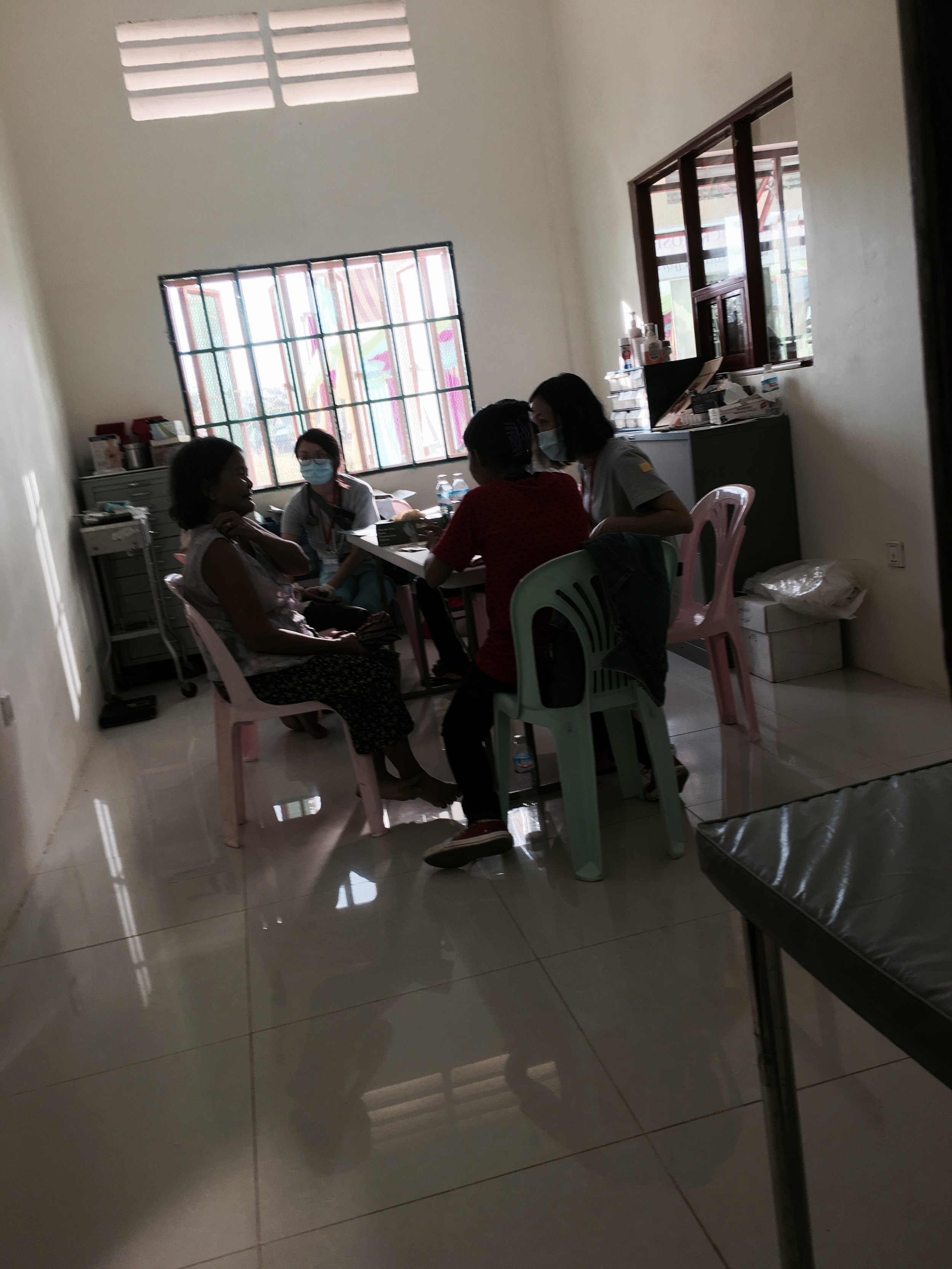 Consultation area, the doctors being assisted by the translators