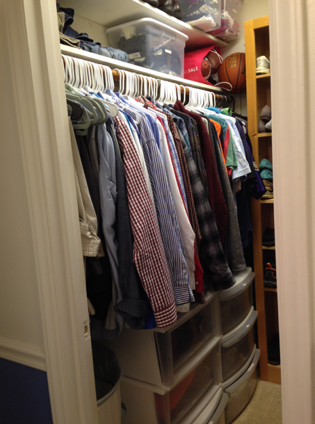 A closet recently organized on a budger...similar hangers help to create uniformity, and plastic drawers add storage.
