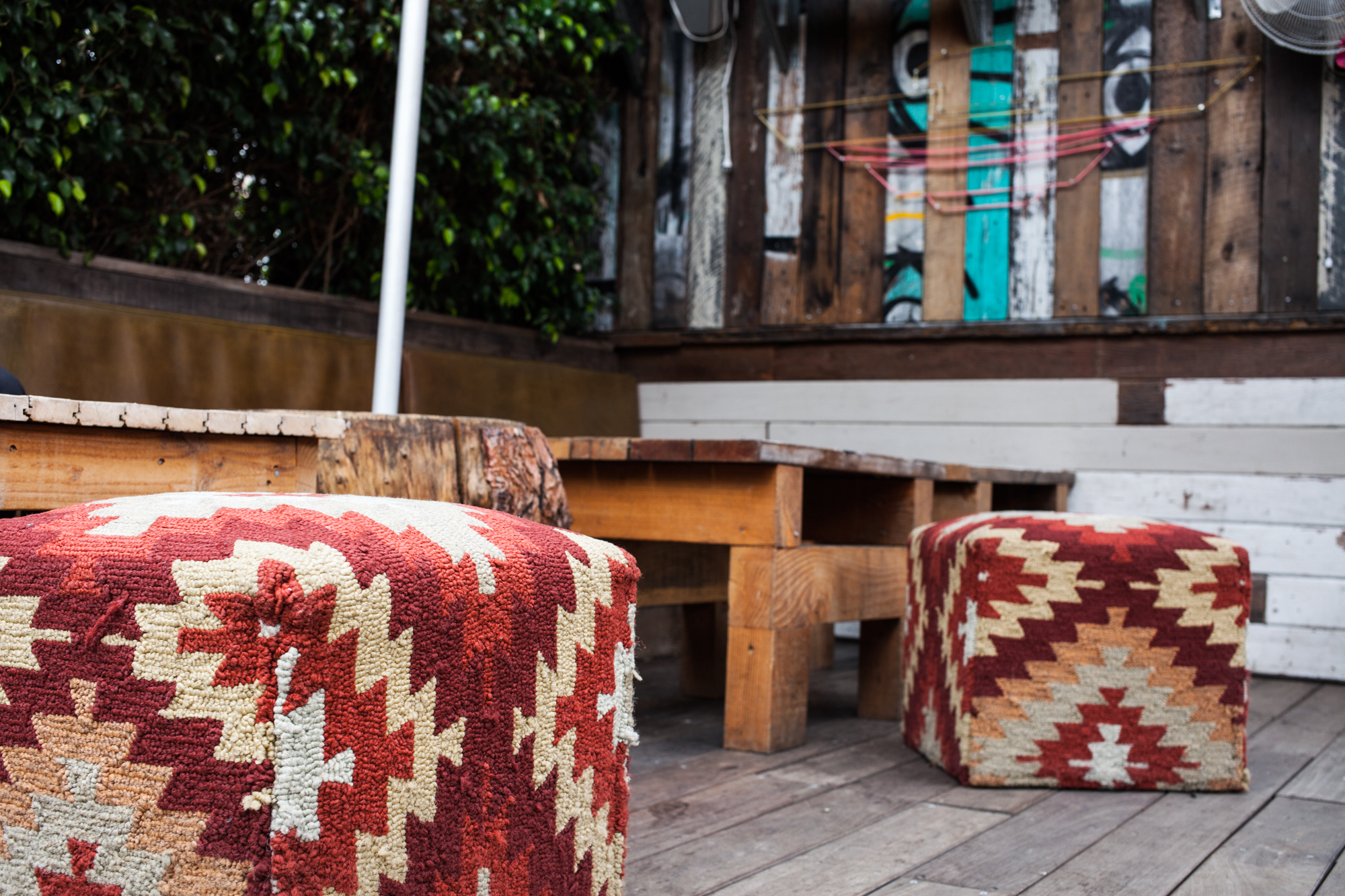 Patio inspiration: weather-proof poufs for a dash of color.