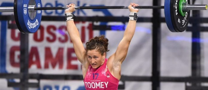 3-time Crossfit Games Champ, Tia Claire-Toomey, with the barbell overhead.