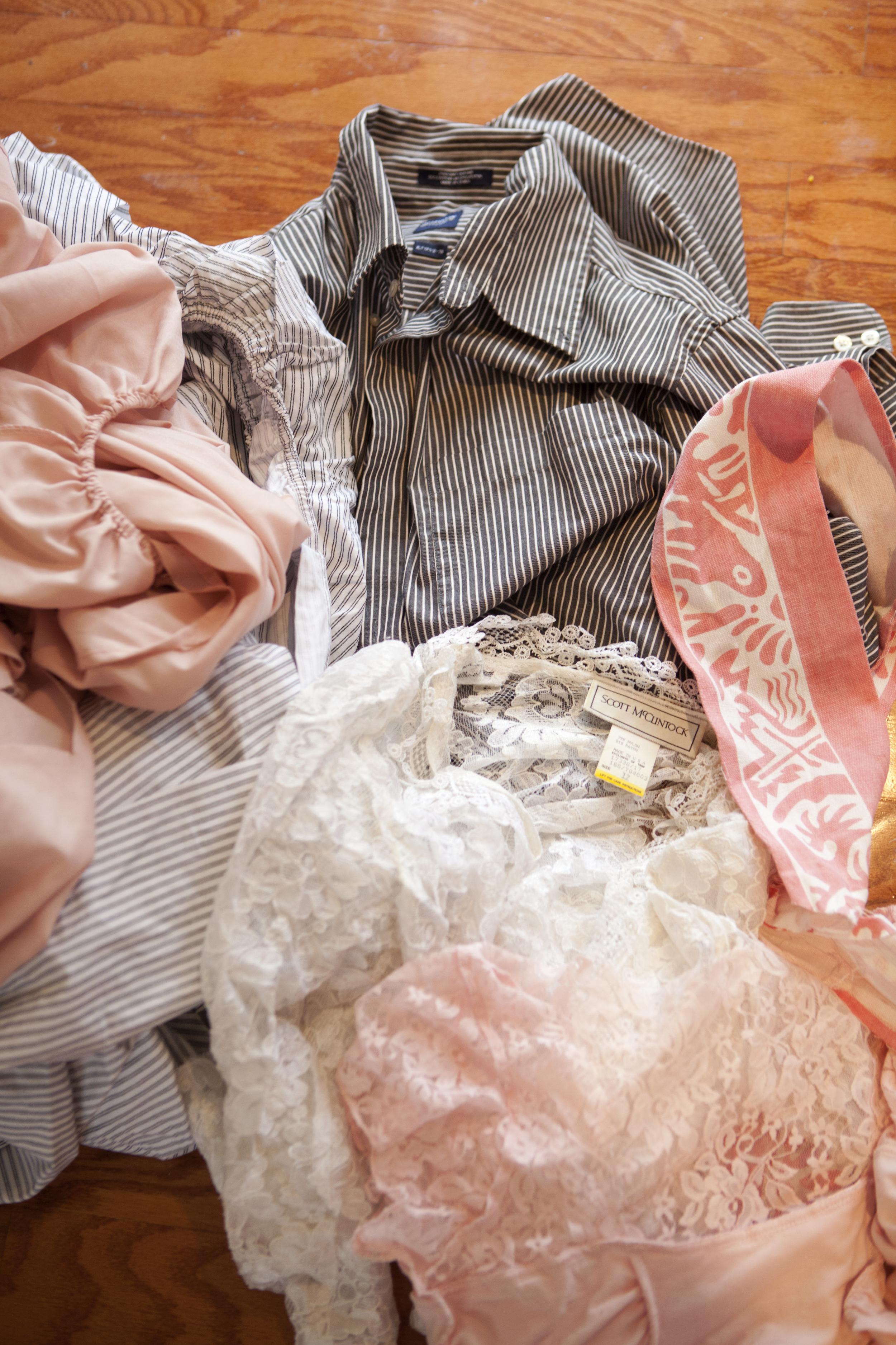 Here is a look at my fabric pile that fit our color scheme of greys and pinks: 2 fitted sheets, one men's button up,  and the pink and white pattern was a table cloth border.