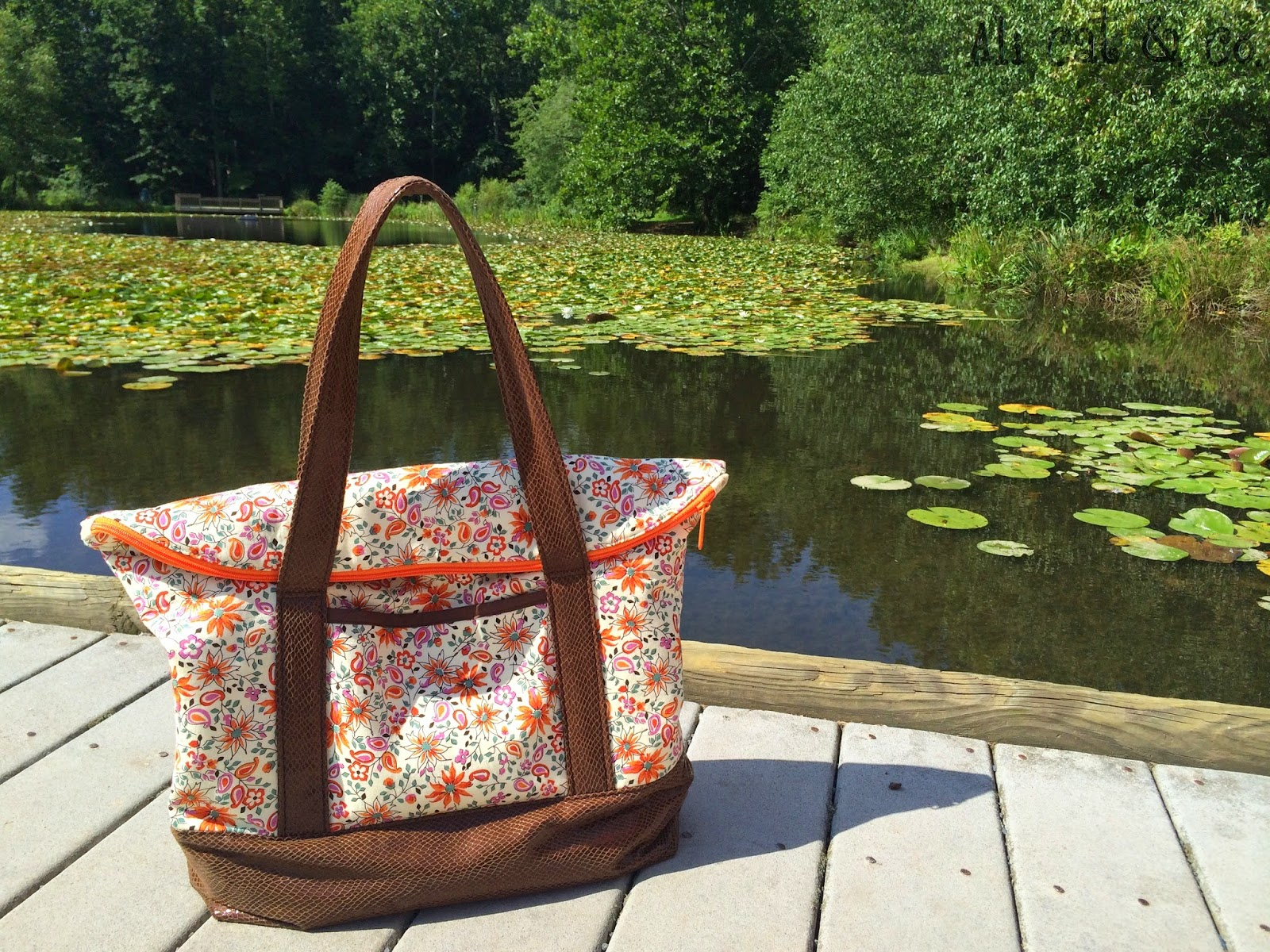 Brianne paired snakeskin with a floral print for her fall inspired Senna Bag