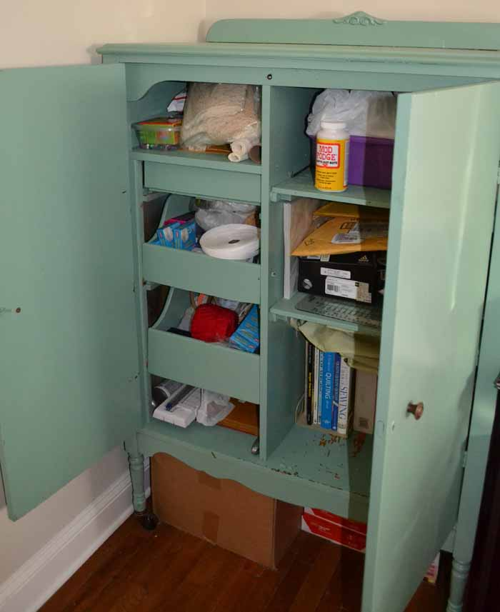 Filled with books, office supplies, sewing supplies