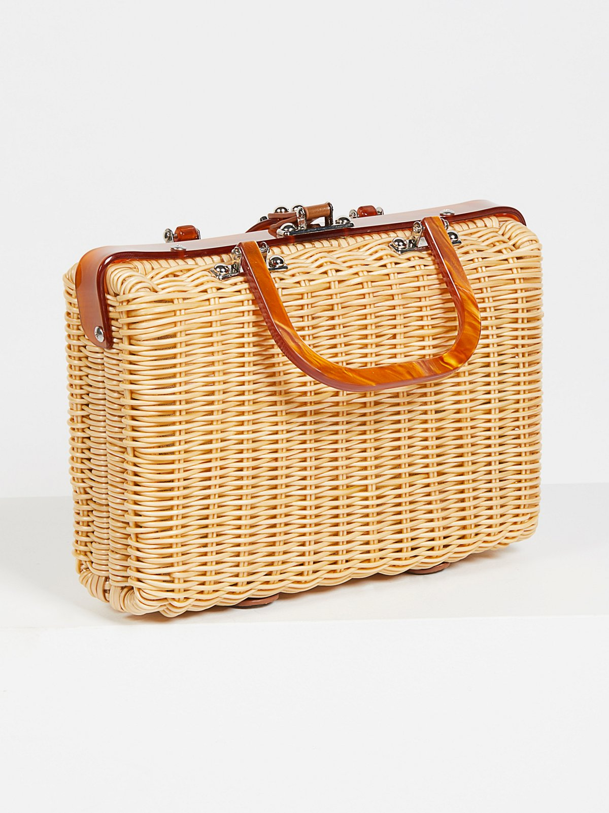 PICNIC BASKET BAG - This bag is the modern update to a basket bag once carried by Jane Birkin. The most stylish of the bunch, this is a more structured, true handbag. A sweet addition to a sundress, but just as good with jeans, its easy to fit a slim wallet, cellphone, and makeup essentials.