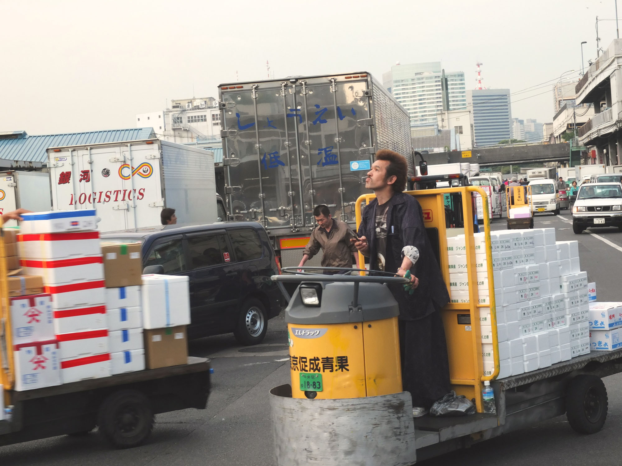 The workers at Tsukiji are masters at driving these transport vehicles around. They also don't stop for nobody.