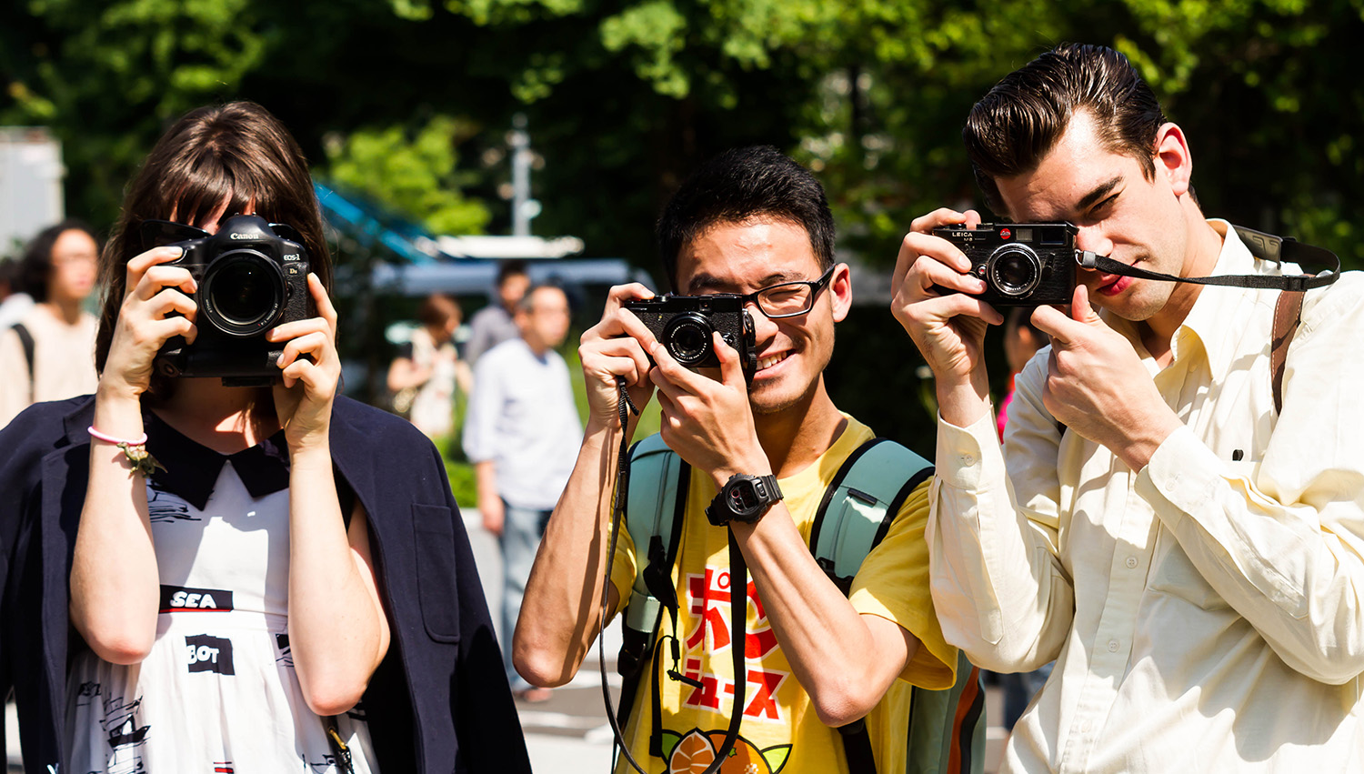 Some camera loving people. (I really want that guys camera...)