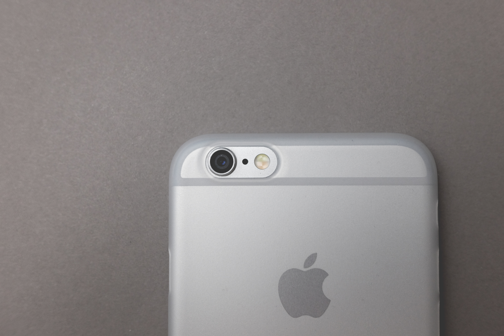 The frosted clear case offers a nice texture and enough clarity that the iPhone's design elements still remain visible.