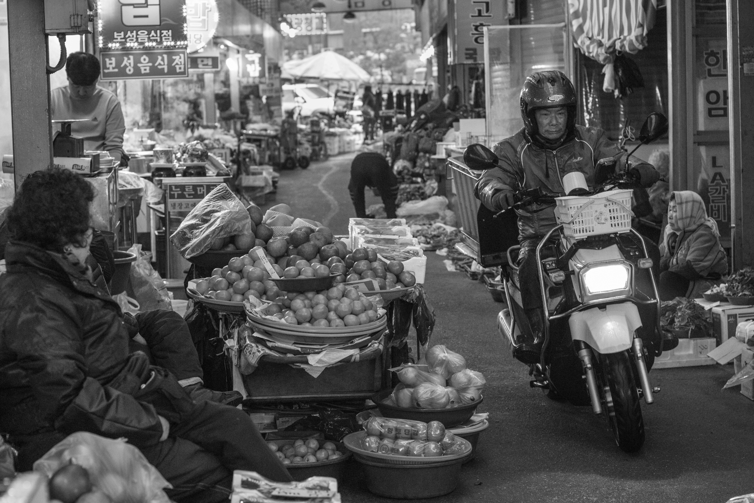 Though the streets through the markets are actually quite wide, many merchants display their wares in the road itself, thus choking them to narrow, winding paths. Despite little room for error, motorcycle-delivery men cruise through at breakneck speeds. No one in the market bats an eye.