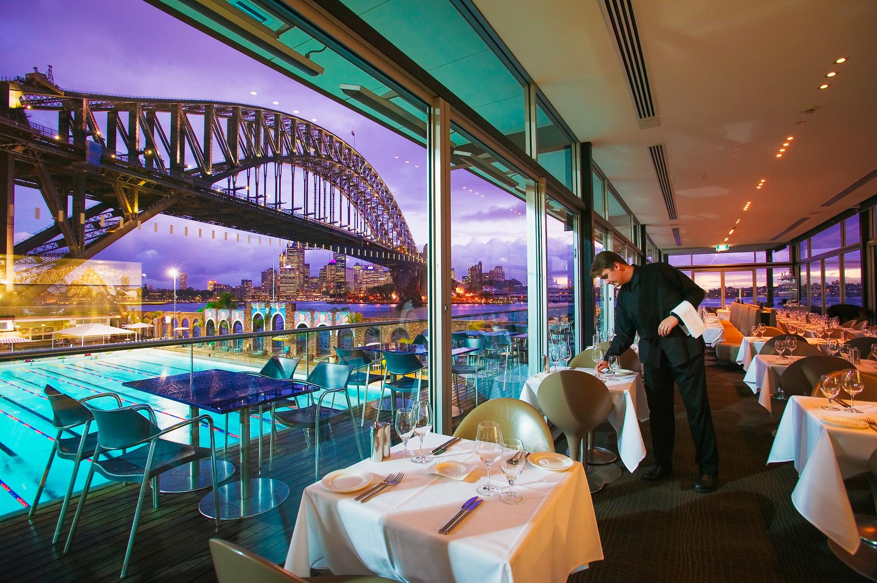 Aqua Dining restaurant at Milsons Point, overlooking Luna Park, North Sydney Pool and the Sydney Harbour Bridge.