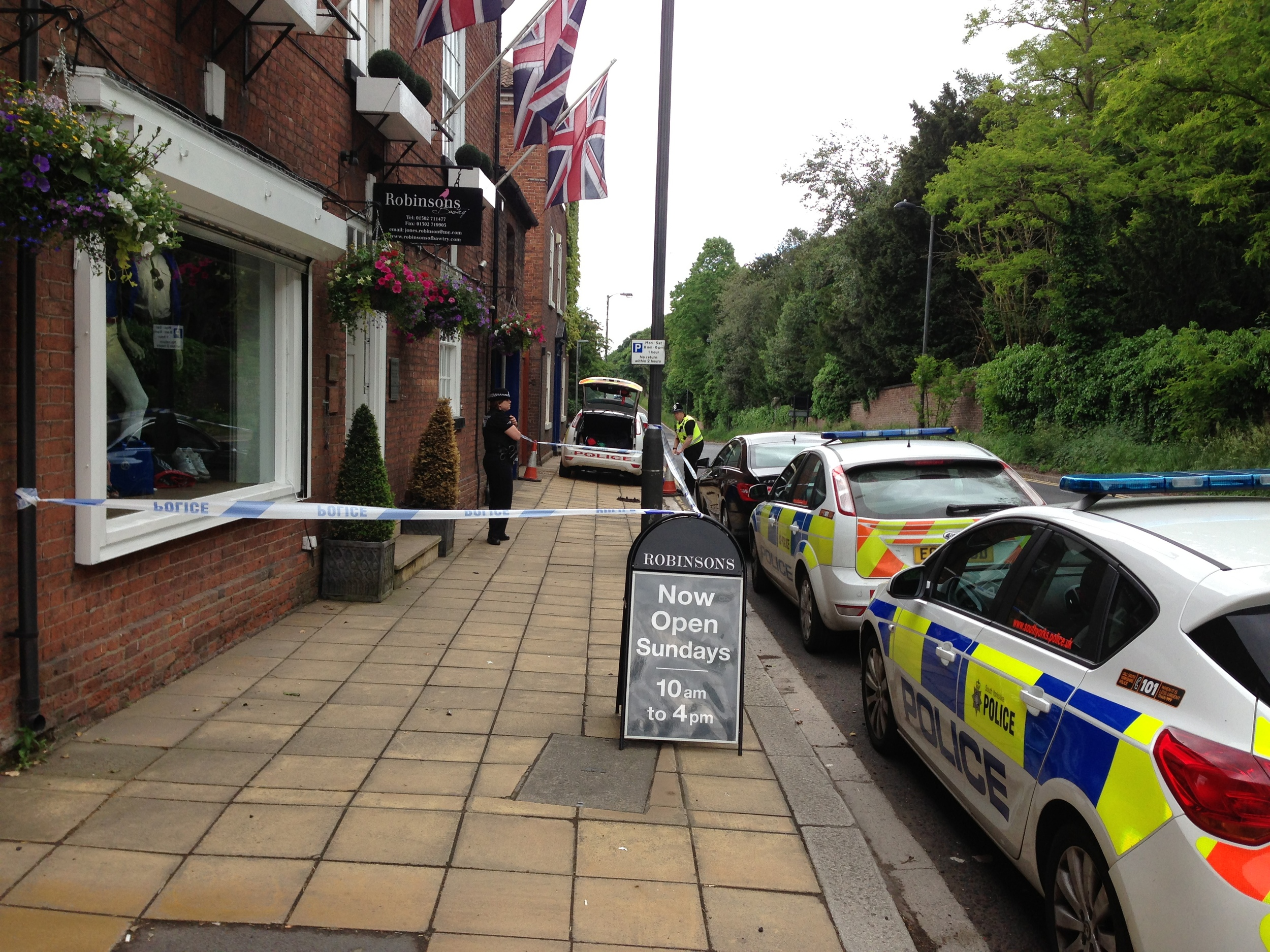 South Yorkshire Police in attendance at Robinsons of Bawtry following the armed robbery.