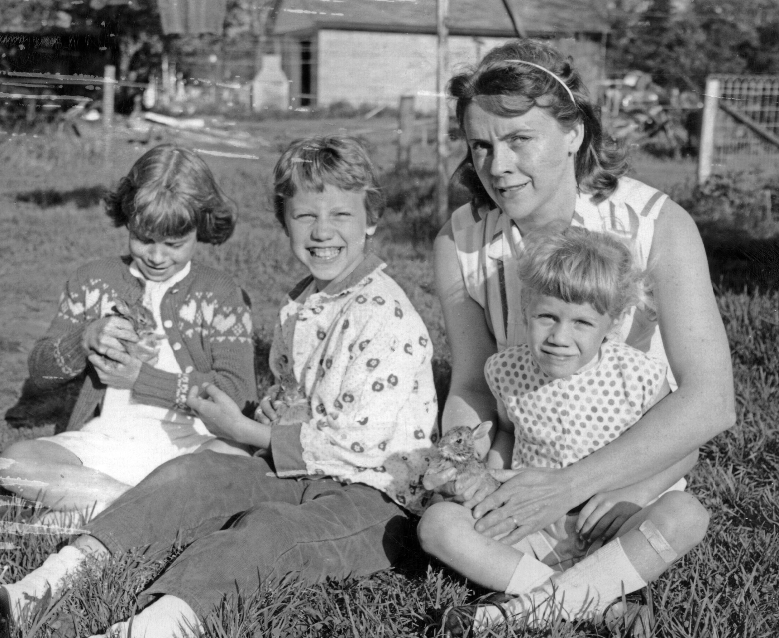 The three oldest kids with Mom and baby bunnies. (I'm the youngest.)