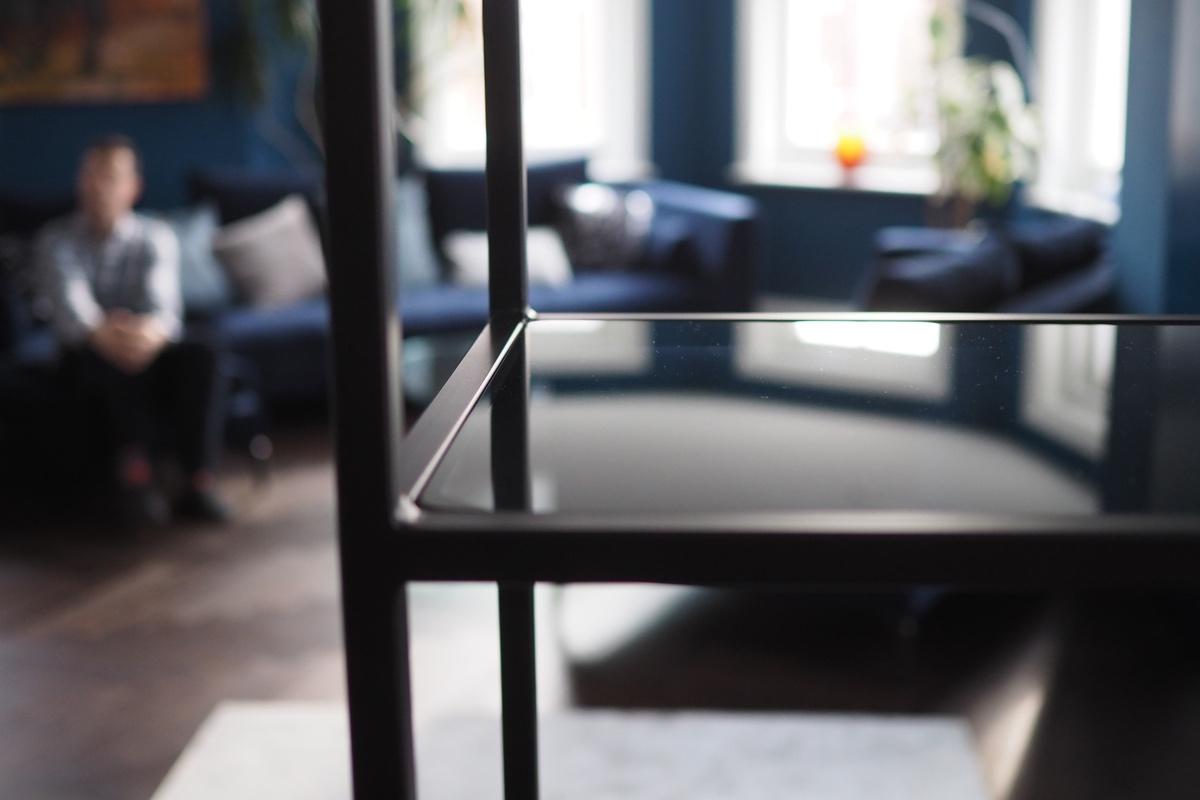 black metal frame shelving unit lounge.jpg
