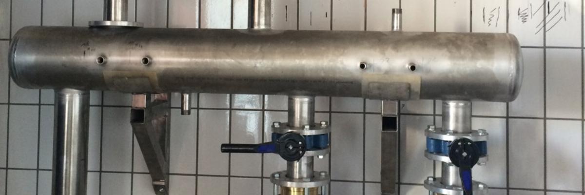 Compensatore idraulico per impianto di refrigerazione industriale