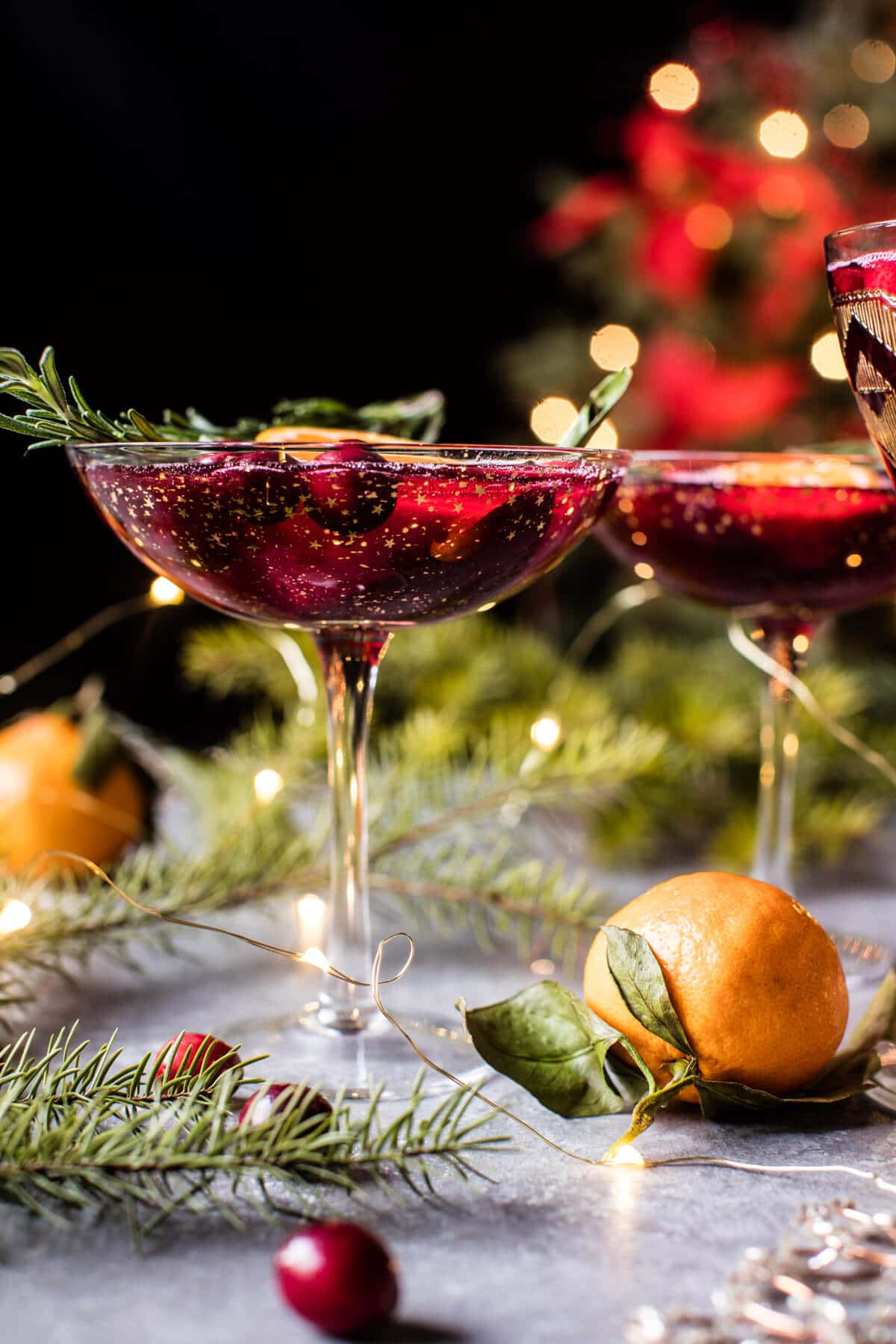 Poinsettia Spritz Punch - 3/4 cup vodka1 1/2 cup 100% cranberry juice or pomegranate juice2 ounces St. Germain elderflower liquor3/4 cup champagne1 cup fresh cranberriesslices of orange and sprigs of rosemary as garnish