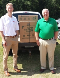 Sean Knowles of McLean Engineering (L) presents Mike McGee, Senior Vice President at Middle Georgia/Irwin EMCs, with the Big Green Egg.