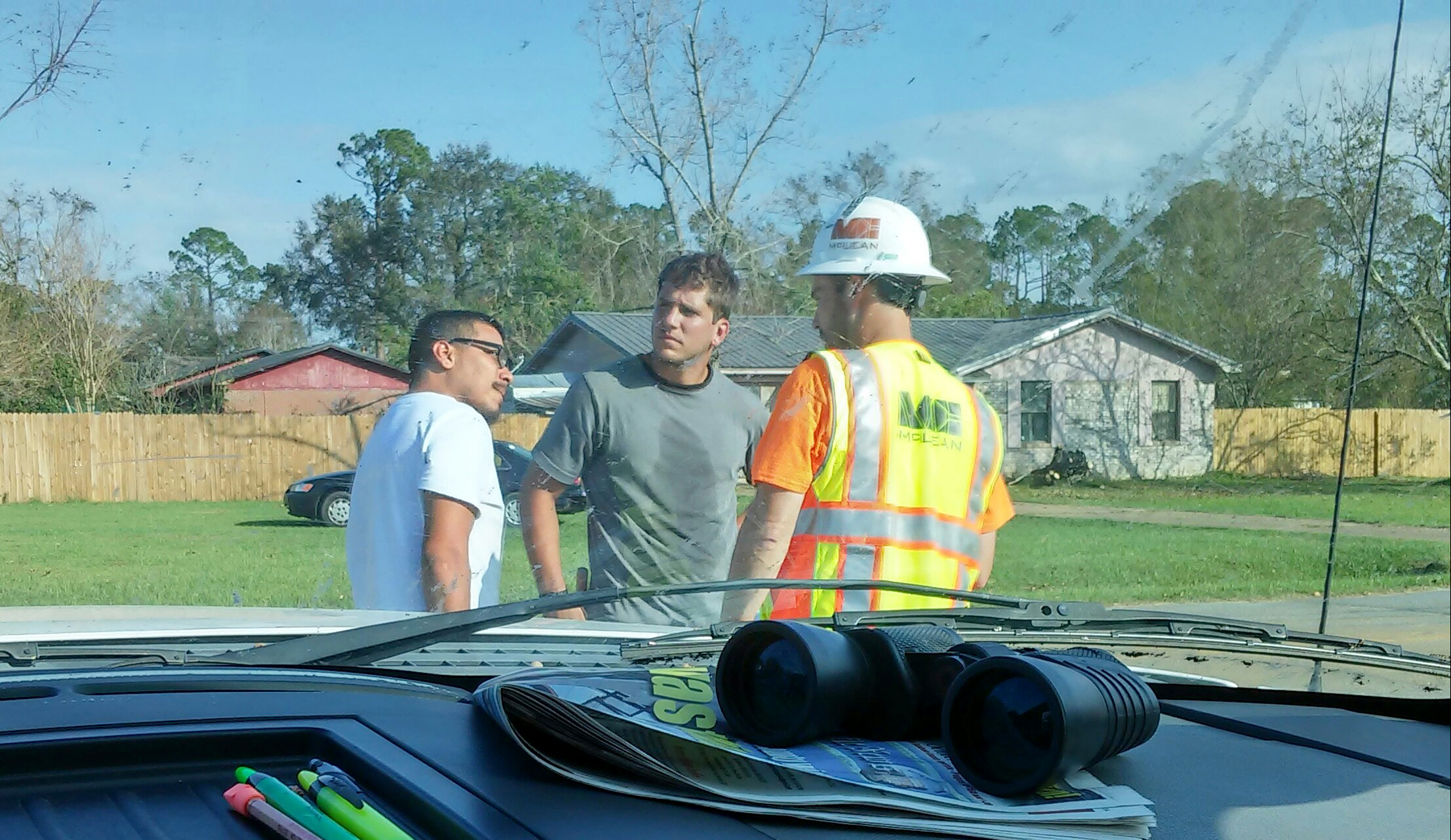 McLean's Jeffrey Durrence speaks with residents affected by the storm.