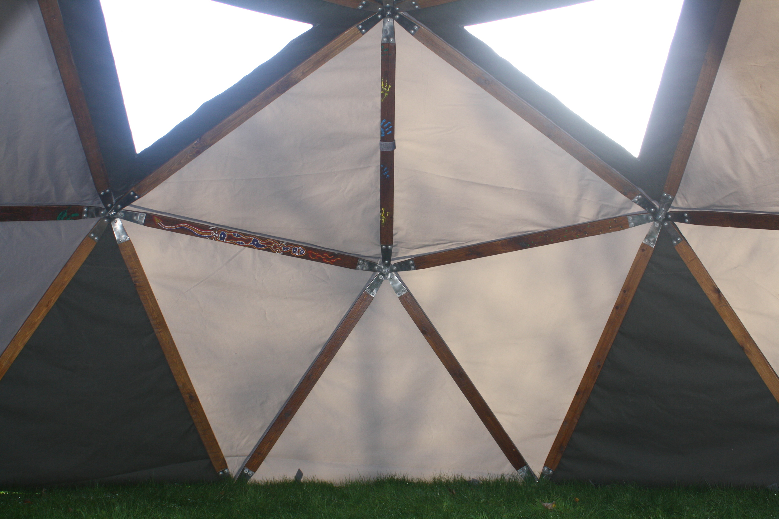 Inside one of domemade's geodesic domes with weathermax FR cover.