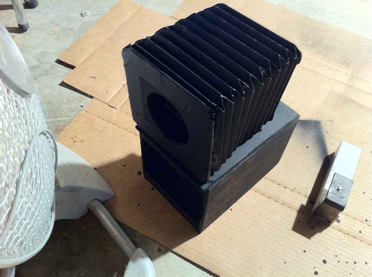I then folded a bellows out of stiff paper and cloth tape. The bellows provides me with a push-to-focus functionality