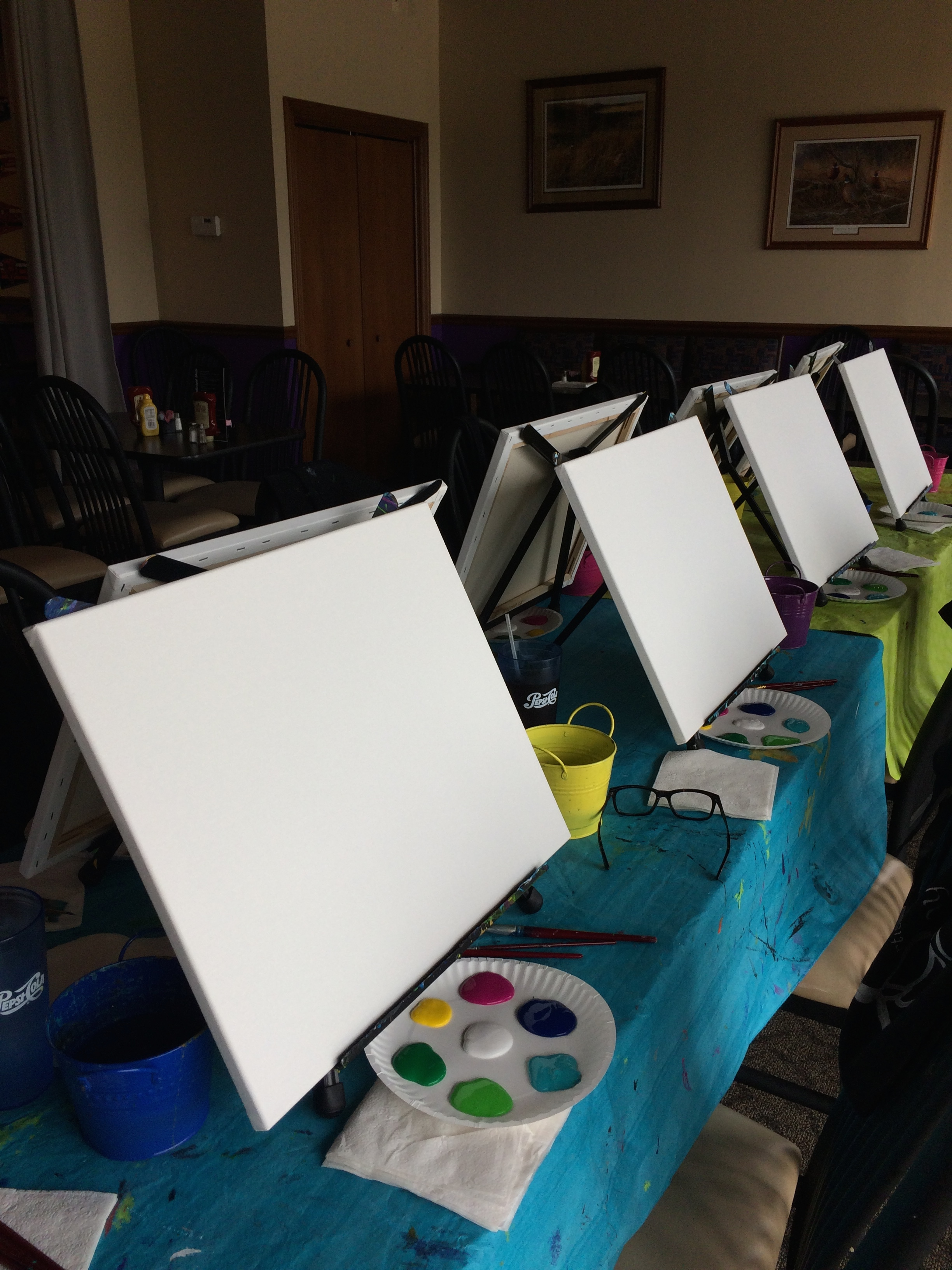 We bring the art supplies, table cloths, easels, canvas and aprons.