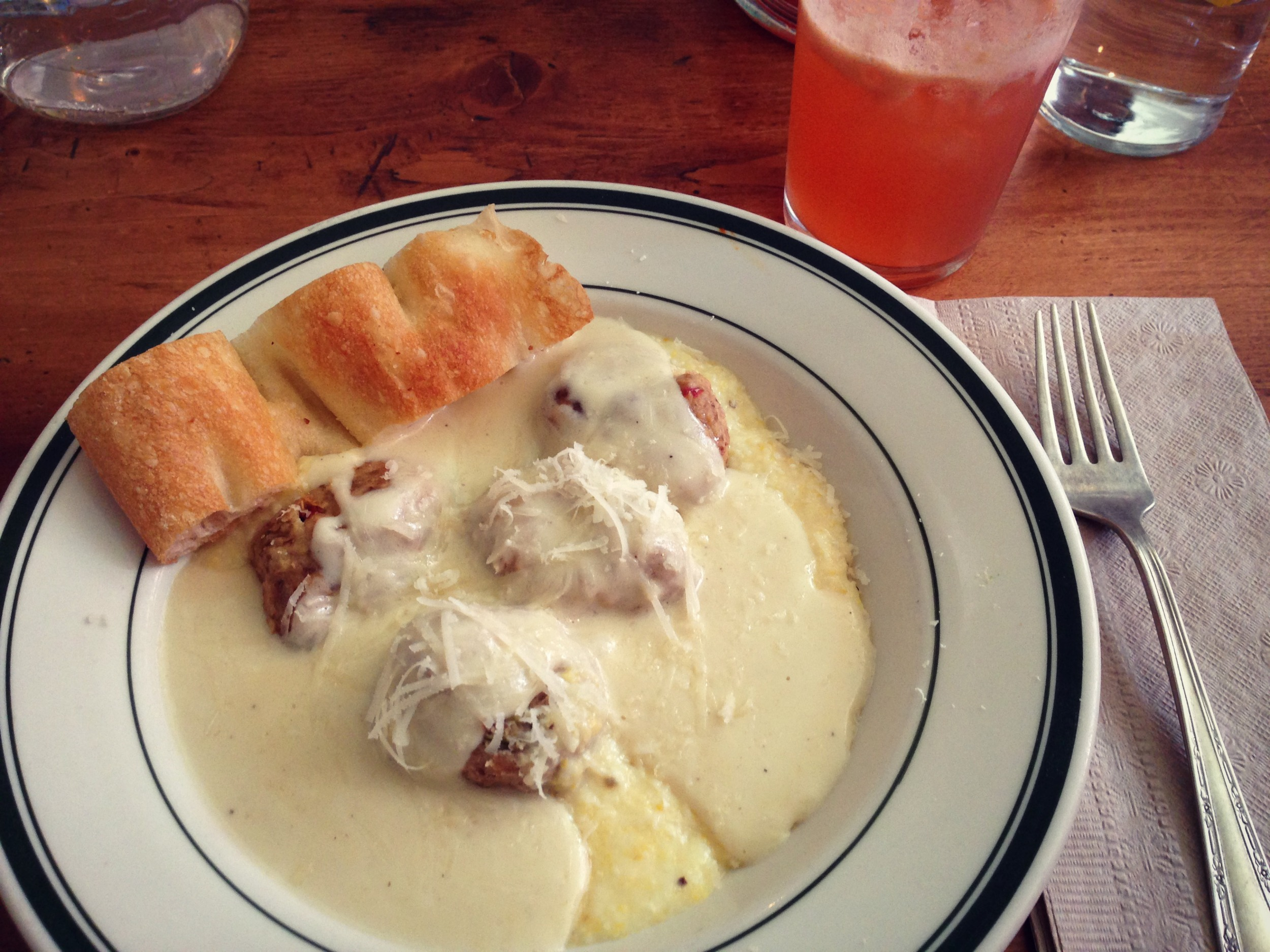 {fresh milled polenta, spicy pork meatball, and parmesan alfredo sauce}